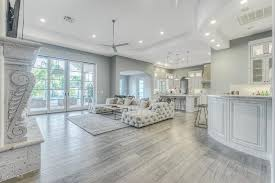 contemporary living room with hardwood floors french doors restoration hardware soho tufted upholstered uchaise sectional living room hardwood floor ideas12 floor