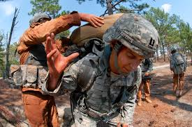 u s department of defense photo essay  a u s army officer helps brigade physical therapist capt steven kovach load a