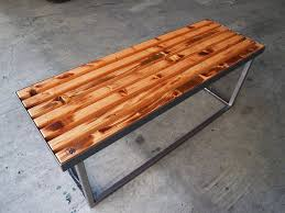 Reclaimed wooden slats on metal frame.
