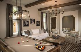 beige pool table in living room traditional with white sofaand striped area rug