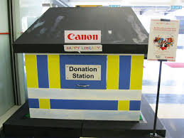 corporate social responsibility canon business happy library book and toy donation campaign