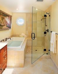 2. Compact Elegant White Tiled Bathtub And Shower Combo