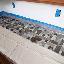 Dry lay tiles along countertop prior to installing on wall.