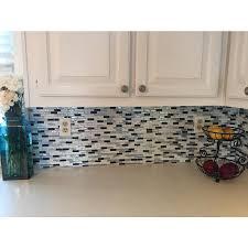 muretto brina smart tiles muretto brina muretto brina this l and stick backsplash brings light metallic blue in a beige kitchen