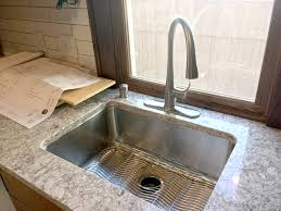 kitchen sink with faucet installed the same quartz
