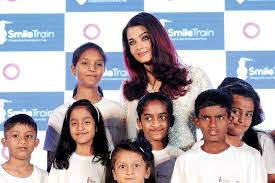 indian bollywood actress and and smile train goodwill ambador aishwarya rai bachchan poses for a pictures with children during a smile train event