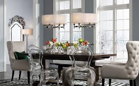 a transitional dining room with two contemporary pendants and a floor lamp