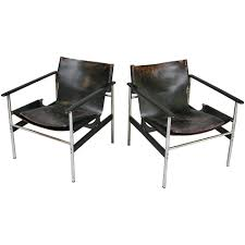 vintage chrome and leather lounge chairs by charles pollock for