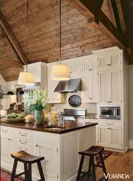 beadboard ceilings installation and pros and cons. This Rustic Kitchen Features A Sloped Wooden Ceiling Leading To Beadboard Cabinets And Island With Chopping-block Top, All By Wood-Mode. - Veranda.com Ceilings Installation Pros Cons