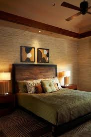 bedroom stripes grey and white cushion carved dark wood headboard unfinished cream wall painting modern