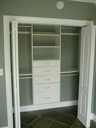 closet design with white wooden door and white closet system
