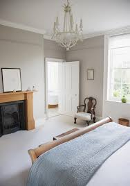 big master bedrooms couch bedroom fireplace: this crisp and clean bedroom has a beautiful black cast iron fireplace a squat