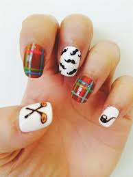 paint a mustache with black nail polish on the middle fingernail paint a pipe with dark brown nail polish on the pinky fingernail add golf clubs with dark