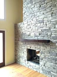 laying stone veneer good stone facade fireplace for view more of our stone fireplace build stone