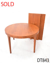 1960s danish circular dining table with 2 leaves extends to seat 8