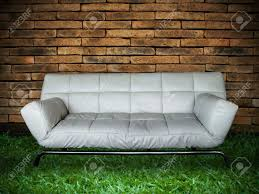 Grass Couch White Sofa Old Brick Wall And New Green Grass Stock Photo Picture