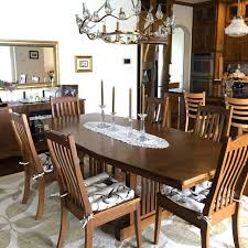 her new song bird dining chair pads match perfectly with her graceful neutral rug and that amazing gl birds chandelier birds chandelier diningroom