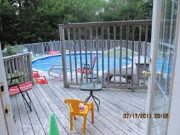 Above ground pool with deck attached to house Free Standing Decksgo How To Add Deck On To An Existing Above Ground Pool Deck