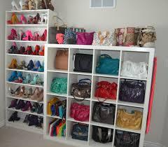 ravishing walk in closet with white shoe rack and handbag