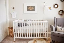 nursery with white furniture. gender neutral baby nursery with white crib and wall mirrors furniture n