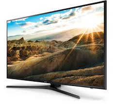 samsung tv 70 inch. a right perspective angle of samsung uhd tv with bright landscape onscreen image. tv 70 inch u