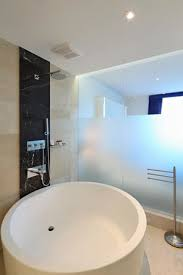 the one boutique hotel standard room extra large soaking round bath tub with rainfall shower