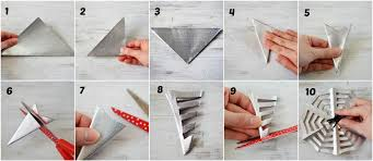 1 Fold origami paper in half to make a triangle. Crease well.