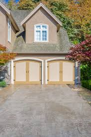 wood garage door styles. Here We Have An Attached, Front Facing Two Car Garage, With Carriage-style Wood Garage Door Styles