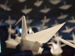 a message is written on the origami of each forming origami crane