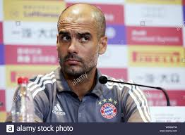 Head coach Pep Guardiola of of Bayern Munich listens to a question at a  press conference for the upcoming friendly soccer match against Inter Milan  in Stock Photo - Alamy