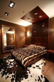 african bedroom decorating ideas. bedroom decorating ideas, dark wood, contrasting room colors, animal skin decoration patterns african ideas