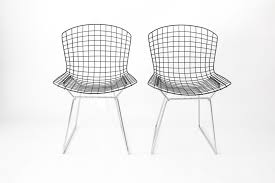 vintage wire chairs with black seats chromed bases by harry bertoia for knoll set of 2