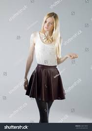 young blonde brunette women wearing leather skirt and white shirt