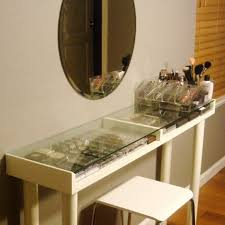narrow makeup vanity table under oval wall mirror and makeup storage under gl top plus white wooden base and stools ideas