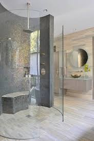 a modern doorless shower in the bathroom
