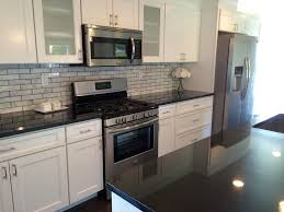 transitional black white kitchen by blankspace llc brown black and white granite countertops