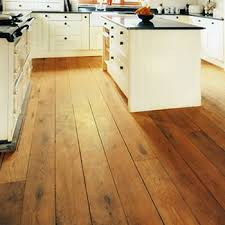 Solid wood flooring for kitchen. Image courtesy by: woodfloorsuk.com