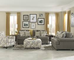 budget living room furniture. Small Living Room With Gray Sofas Patterned Pillows And Table Lamp Above Wooden Drawers On Floor For Cheap Furniture Ideas Budget