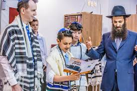 a bar mitzvah celebration can include many rituals such as putting on tefillin