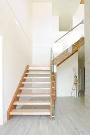 vancouver metallic porcelain tile with contemporary coatracks and umbrella stands staircase modern sunterra glass railing