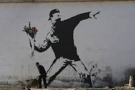 the flower thrower by banksy on most famous wall artist with banksy the richest and most famous robin hood artist in the world