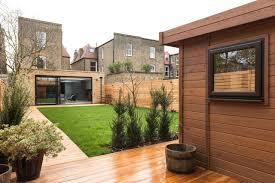 timber garden office. siberian larch decking and garden office cladding transform contemporarygardenshedand timber h