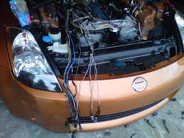 diy wire tuck my350z com forums modified the wire harness cover on the passenger side shortened it about 6 to allow the harness to go to the drivers side instead of the passenger side