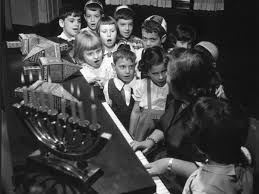 young jewish children gather around the piano circa 1955 to perform songs during the hanukkah celebrations