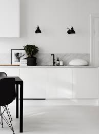 Black Wall Light Fixture In The Kitchen | Image By Kristofer Johnsson Via  Residence Pictures Gallery