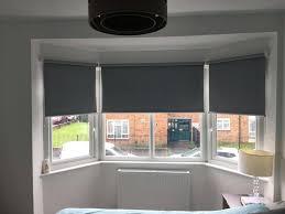 blackout blinds for bedroom blackout roller blinds installed for a bedroom bay window in patterned blackout