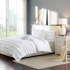 rug for bedroom. white ruffle comforter with nightstand and area rug for bedroom decoration ideas