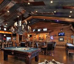 Plain Man Cave Garage Tin Panel Roofing And Animal Antlers Chandeliers Over On Perfect Design