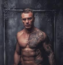 Fotografie Svalnatý Muž S Tetováním 66925041 Fotobanka Fotkyfoto