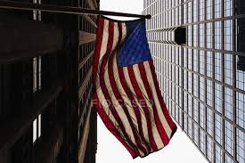 Bottom View Of American Flag And Office Buildings Copy Space